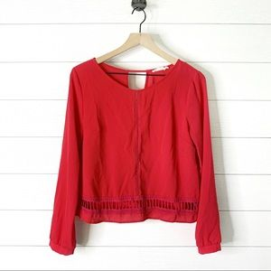 Lush red long sleeve open design top